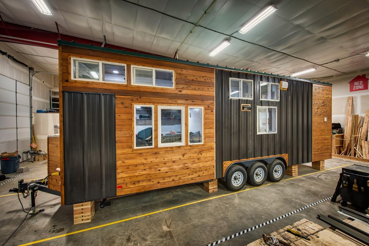 The Grizzly sleeps five people and 11 animals under its compact roof