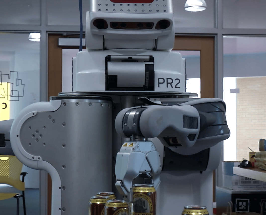 "The humans would push a button on the robot to request a drink, prompting the robot to return to the ""bar"" where a PR2 robot was waiting to dispense cans of beer"