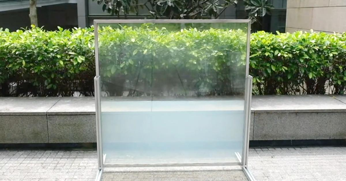 Liquid-filled window absorbs solar heat by day, releases it at night