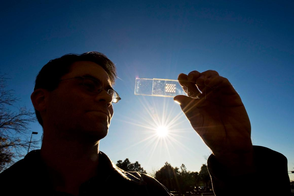 The solar cell test prototype with a microscale lens array fastened above it - the cell and lens help create a concentrated photovoltaic unit (Image: Randy Montoya)