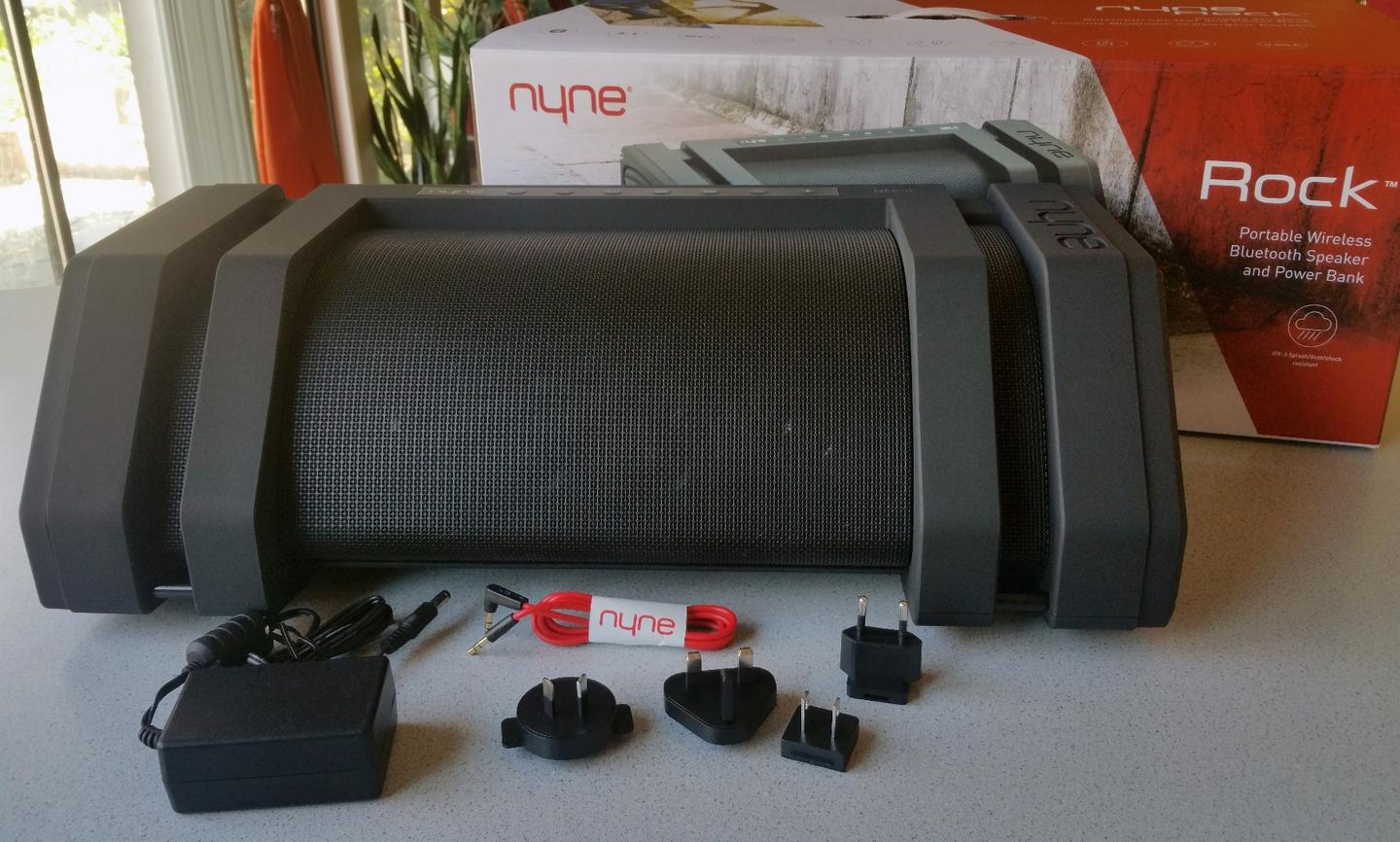 Included with the Nyne Rock is documentation, an audio cable, the wall adapter, and an assortment of international plug tips