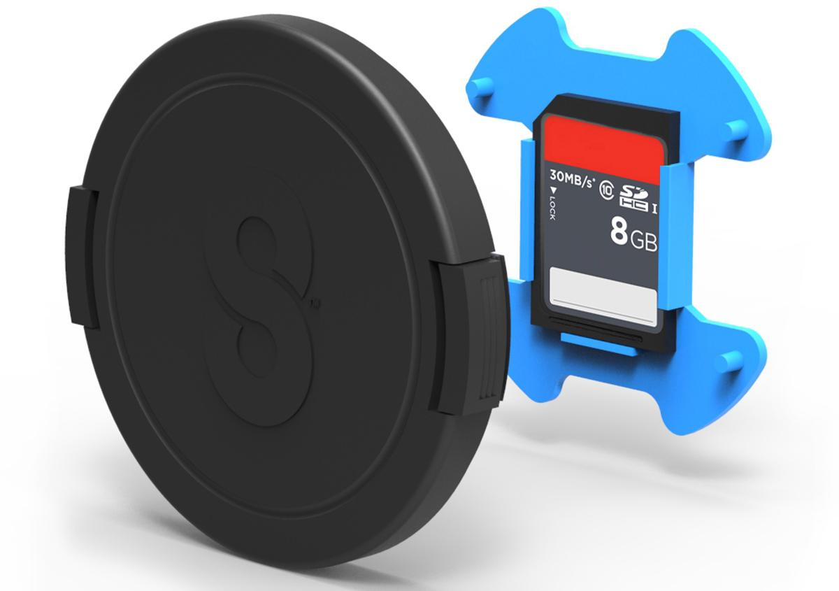 The Snapper Cap protects a lens and adds the storage space needed for stowing a spare memory card