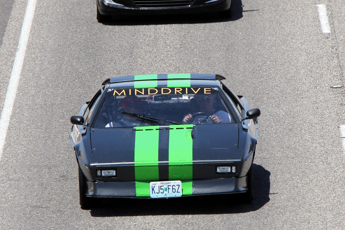 MINDDRIVE mentors and 15 at-risk students converted a 1977 Lotus Esprit to electric-only drive and then drove it coast-to-coast across America