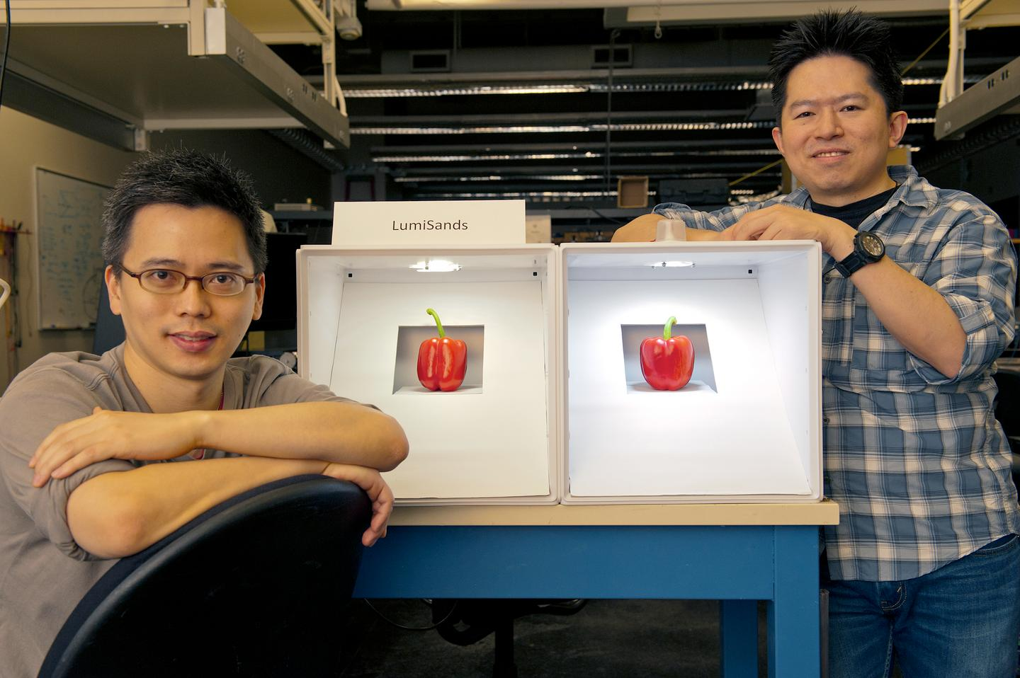 LumiSands founders Chang-Ching Tu (left) and Ji Hoo, demonstrating the warmer hue of an LED bulb utilizing their technology