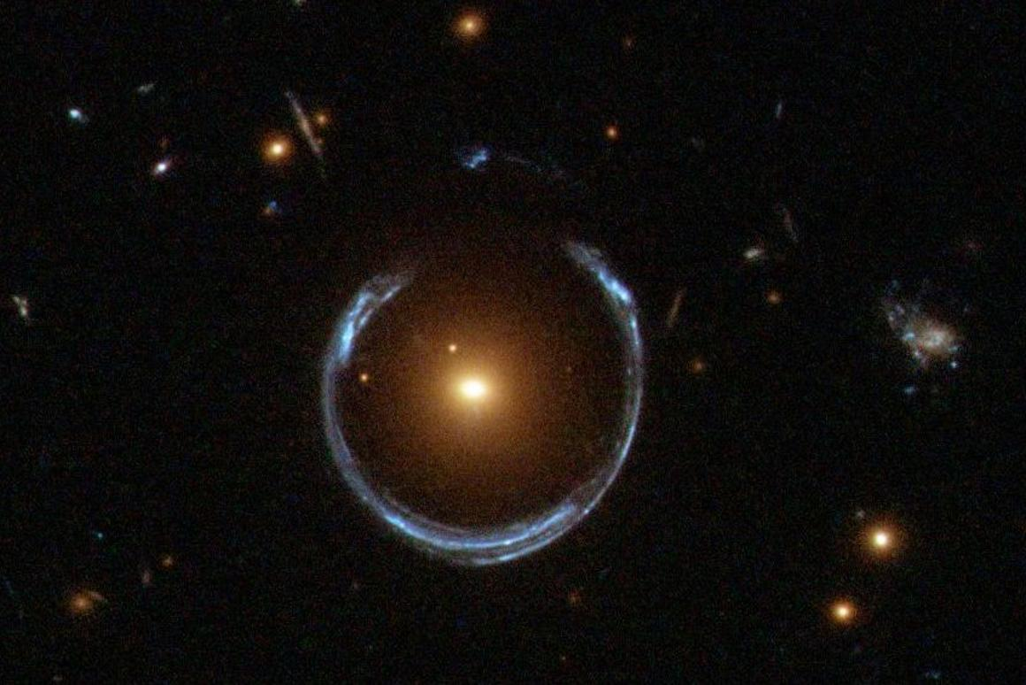 Massive galaxy LRG 3-757 forms a gravitational lens for a second galaxy (blue ring) at a distance of about 11 billion light years