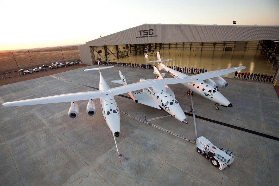 WhiteKnightTwo with SpaceShipTwo spaceplane docked outside the SpaceShip company's hangar FAITH in the Mojave Desert