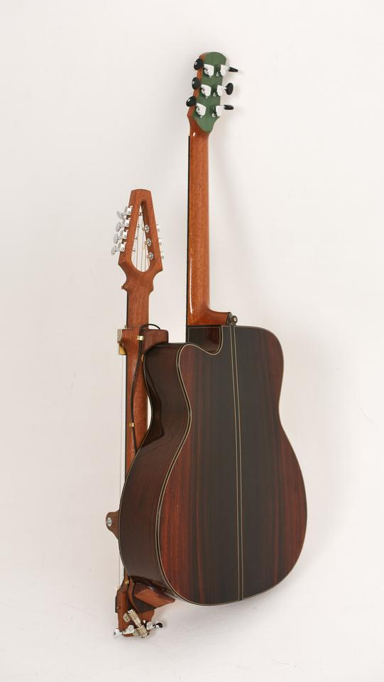 The Reverse Slide Neck attaches to the lower half of a host guitar's body, and can be removed when not needed or during transport