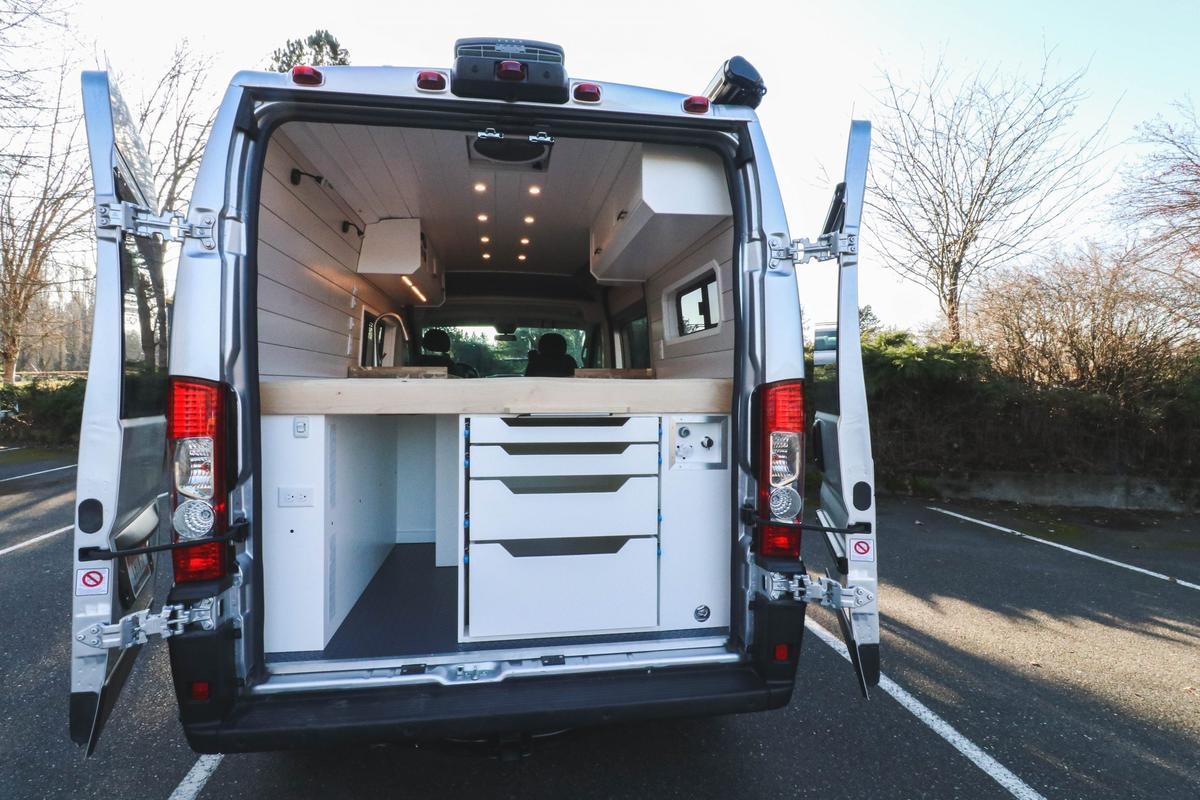 Popping the rear doors on the Chongo camper from Freedom Vans