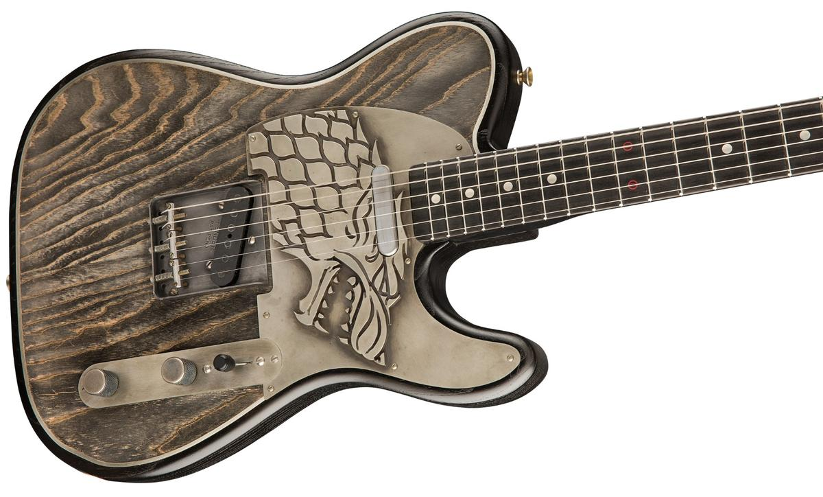 The Game of Thrones House Stark Telecaster features a Dire Wolf sigil embossed in nickel silver on the pickguard