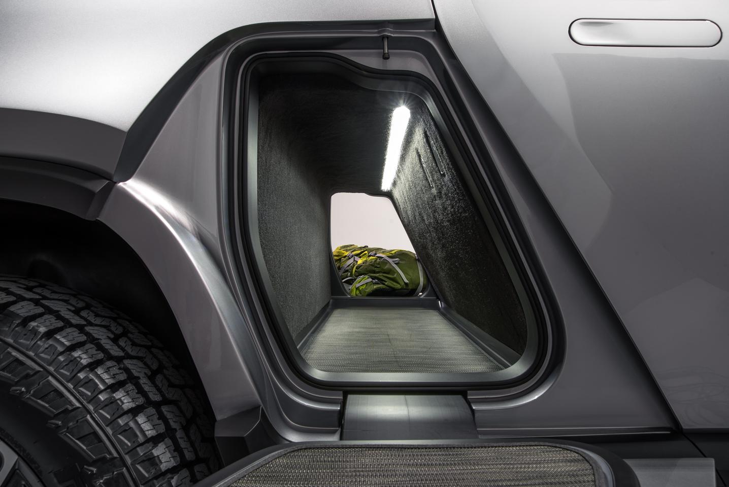 Rivian gives the R1T a storage tunnel that passes cleanly from one side to the other
