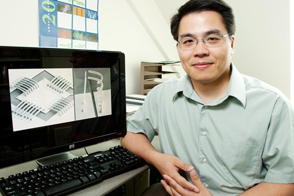 Min-Feng Yu, a professor of mechanical science and engineering, has developed a novel approach for manufacturing metal interconnects (Image: L. Brian Stauffer)