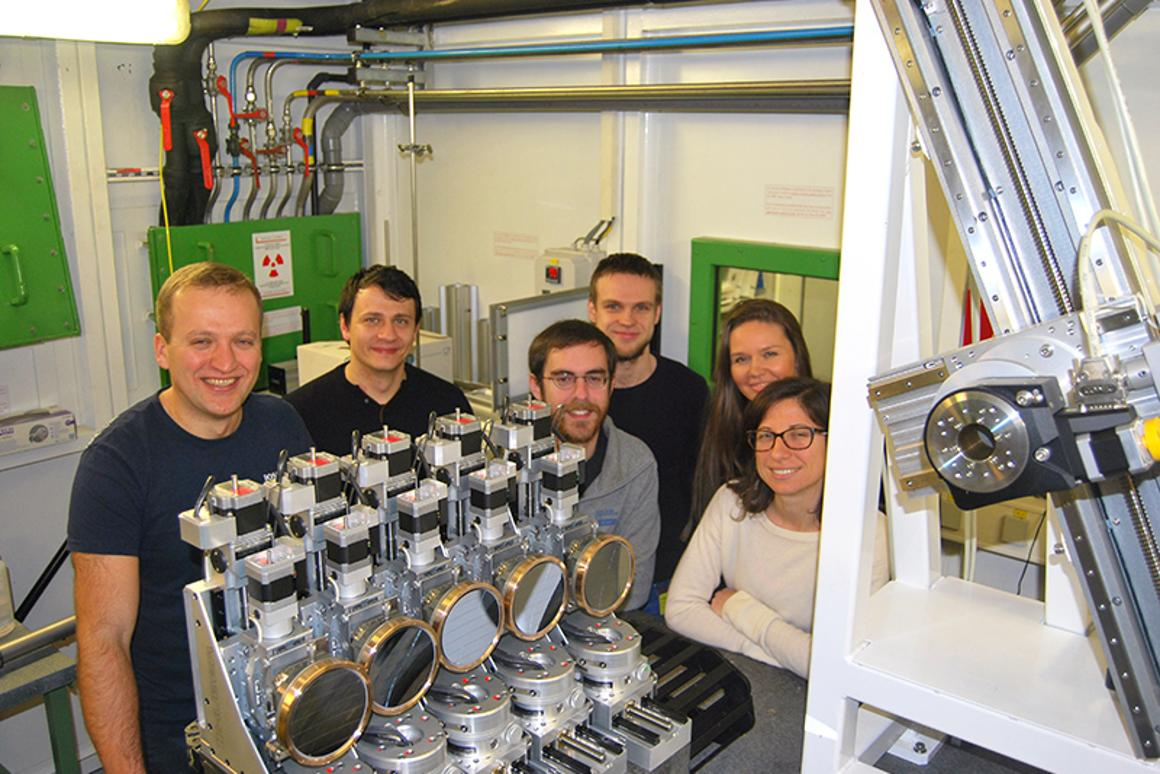 The team who discovered the stable new form of plutonium, standing with the ROBL spectrometer that confirmed the find