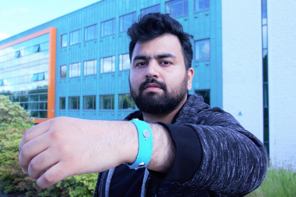 Co-creator Muhammad Umair wearing one of the prototype wristbands