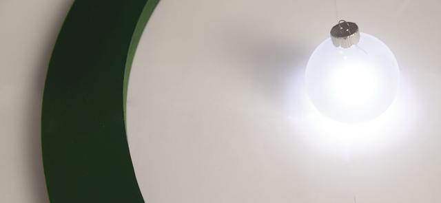 The Aura Power Ring transmits power wirelessly to the LED ornaments