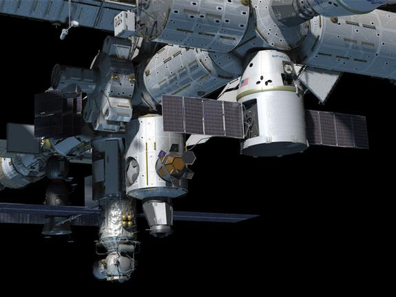 Artist's concept of the SpaceX Dragon capsule docked on the ISS (Image: SpaceX)