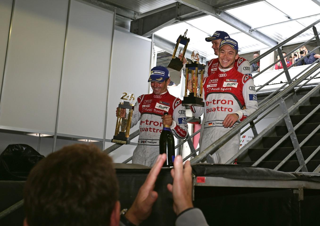 Audi's drivers celebrating post-race