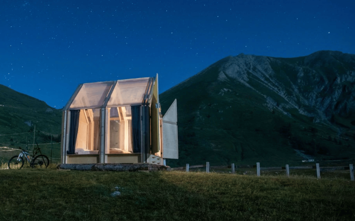 This striking transparent-roof cabin is only 6 square meters (65 sq ft) large and is currently being used as a unique glamping experience in the Italian Alps