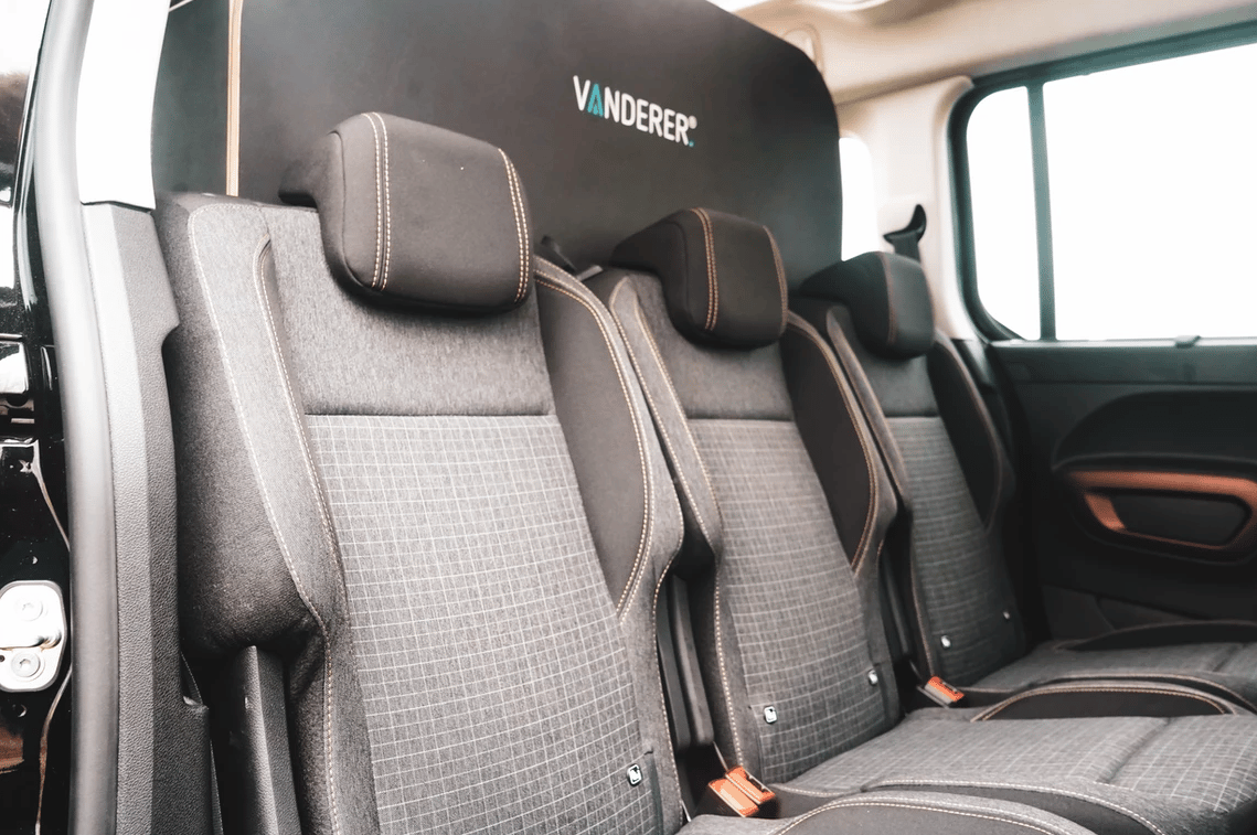 The Vanderer kit sits behind the rear bench during transit, providing seating for five