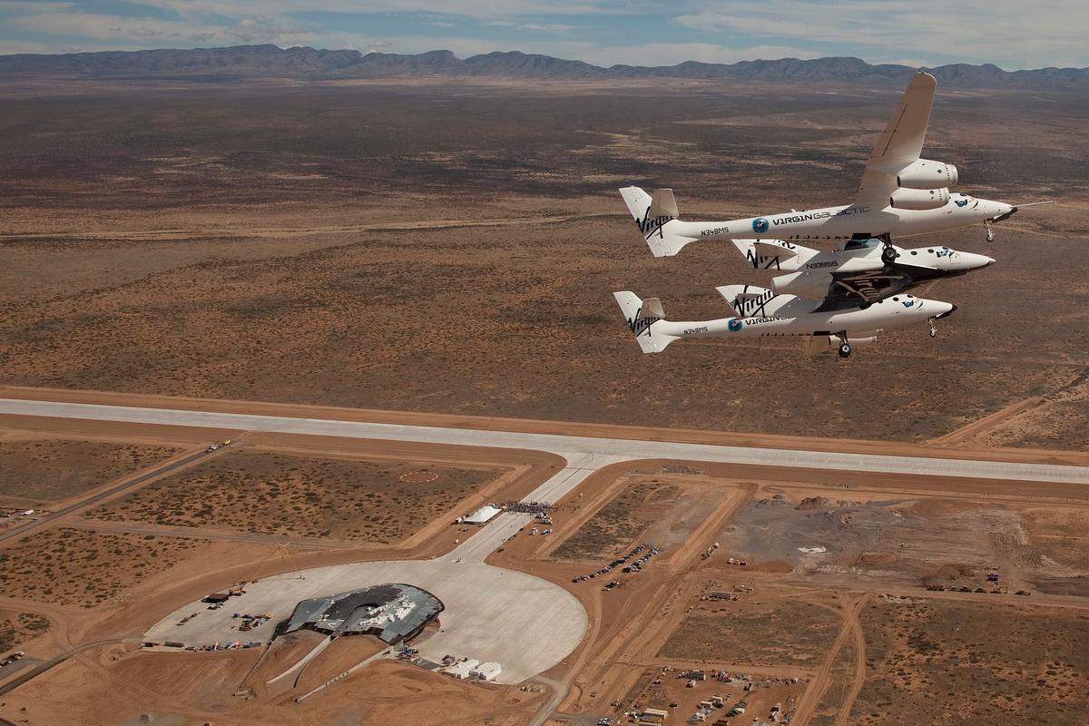 VSS Enterprise flies over the runway dedication ceremony at Spaceport America, New Mexico (Photo: Mark Greenberg)