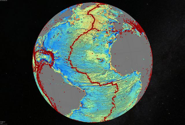 A marine gravity model of the North Atlantic with red dots showing locations of earthquakes with magnitude above 5.5 and highlighting the present-day location of the seafloor spreading ridges and transform faults (Image: David Sandwell, Scripps Institution of Oceanography, UC San Diego)