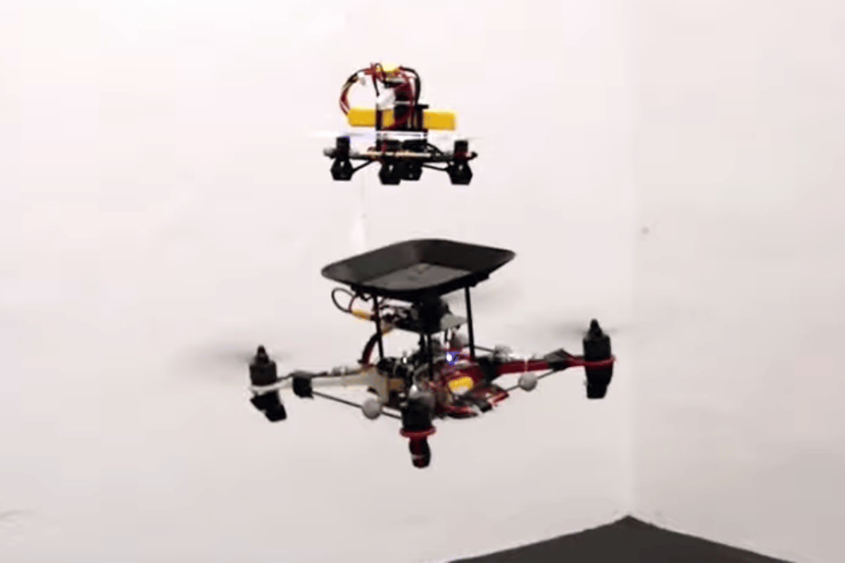 A new in-flight docking system allows a quadcopter's batteries to be topped up by a smaller drone