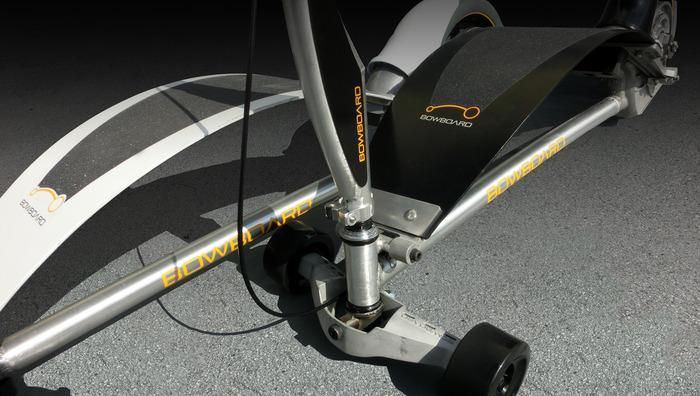 The Bowboard features an arced epoxy springboard above an aluminum alloy chassis