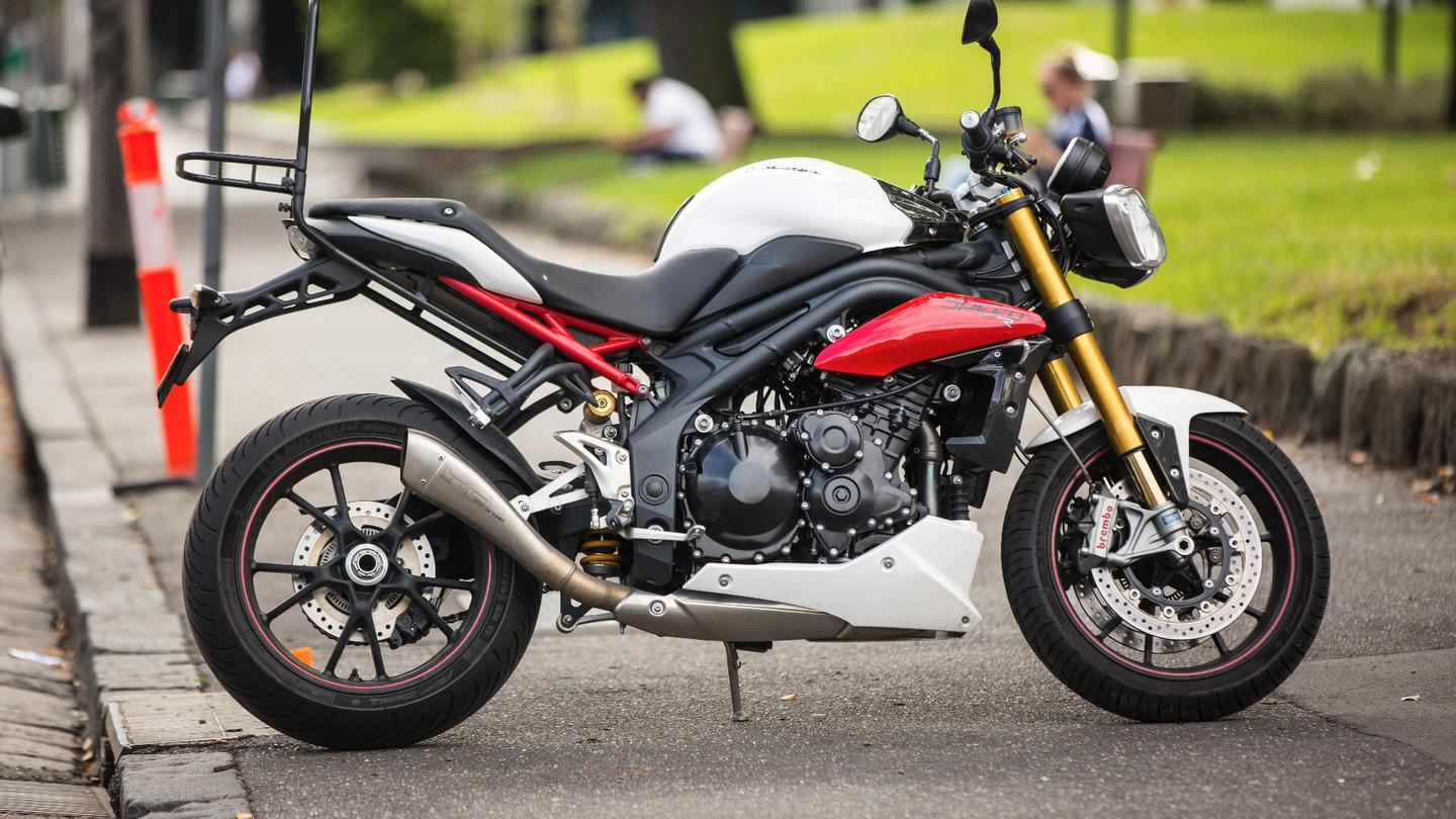 The author's 2014 Speed Triple R, replete with light, low exhaust and luggage rack.