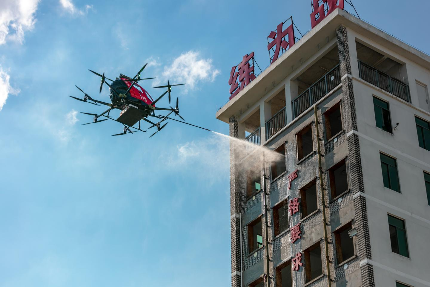 The EHang 216F uses zoom cameras to locate the blaze, and then employs a laser-guided window breaker before launching extinguisher bombs and spraying the fire with foam