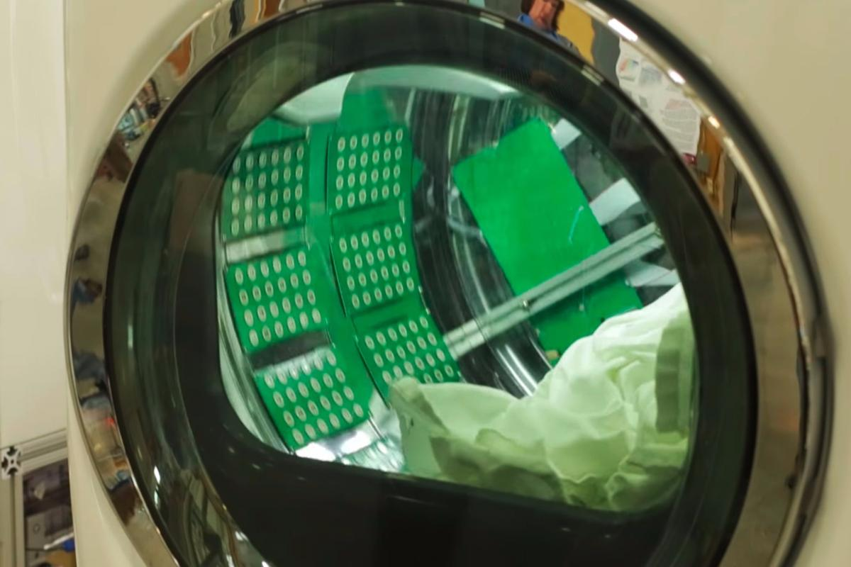 In a step towards commercial availability, ORNL researchers have integrated their ultrasonic drying technology into a clothes dryer drum