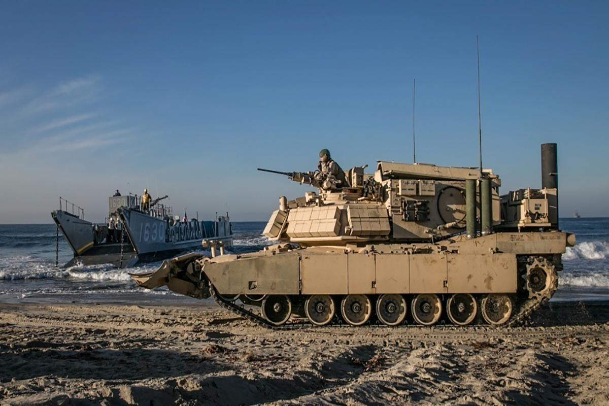 U.S. Marines prepare to load an Assault Breacher Vehicle onto a Landing Craft Utility, something that should be much safer in future thanks to a robotic CRAB vehicle