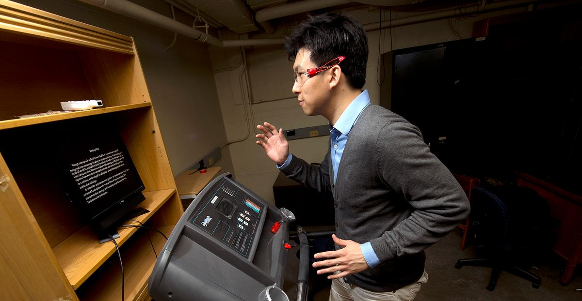 Purdue industrial engineering doctoral candidate Bum chul Kwon demonstrates the ReadingMate system that allows treadmill users to read while they run (Photo: Purdue University photo/Mark Simons)