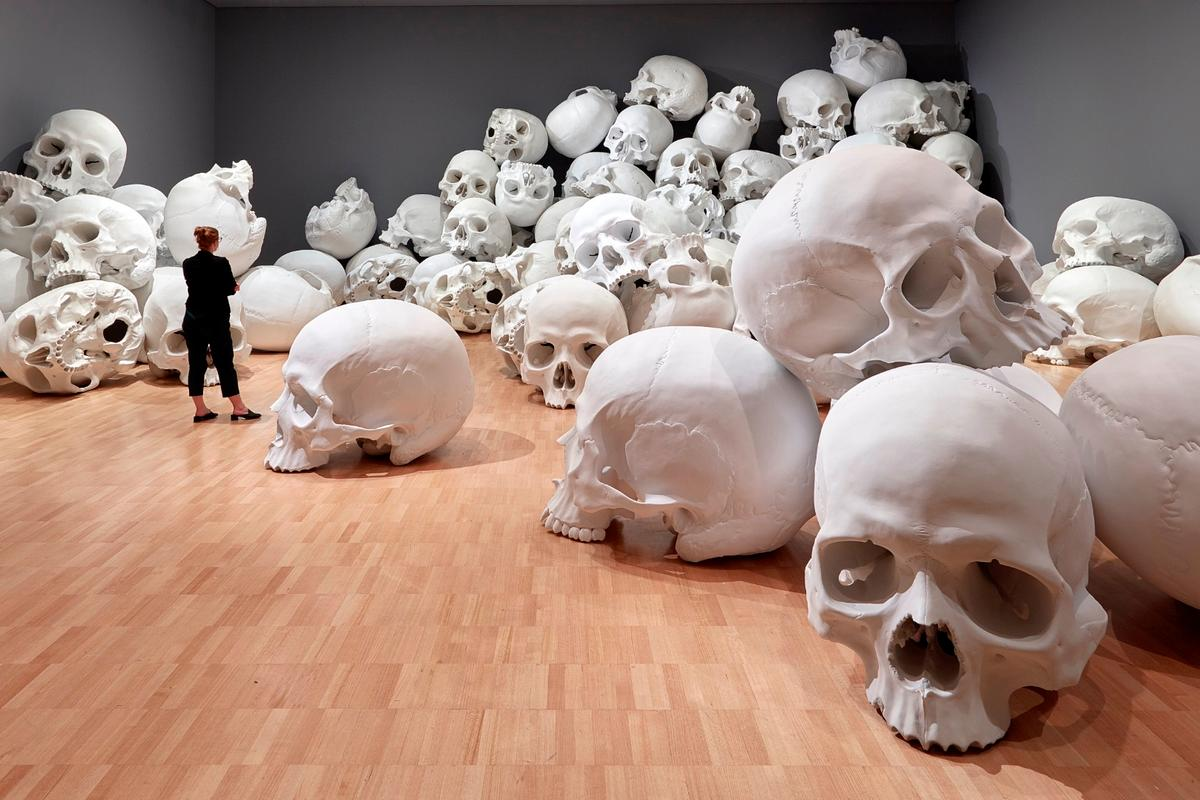 Ron Mueck's huge installation features 100 giant skulls strewn around the gallery's classic art collection