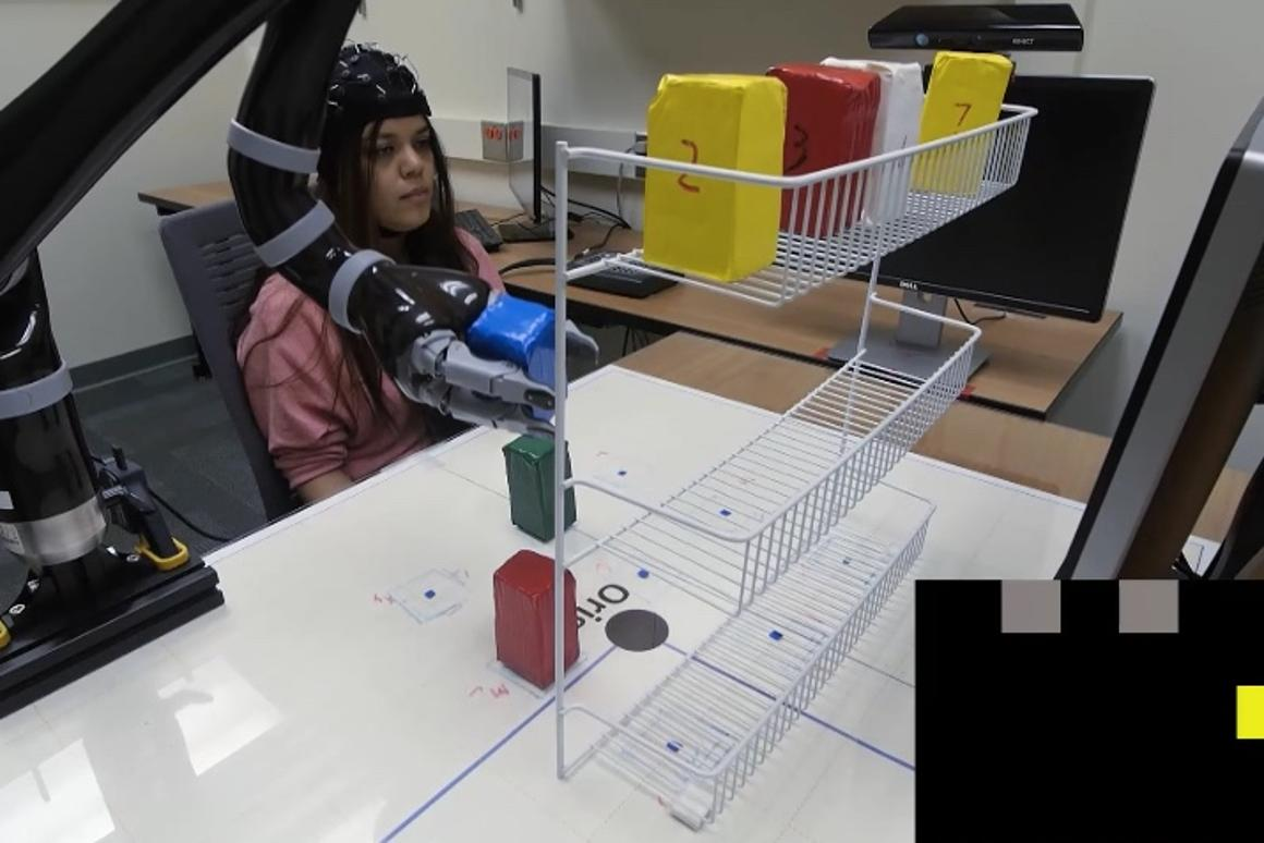 It's all in the mind: the EEG cap lets wearers control the robotic arm with just their thoughts