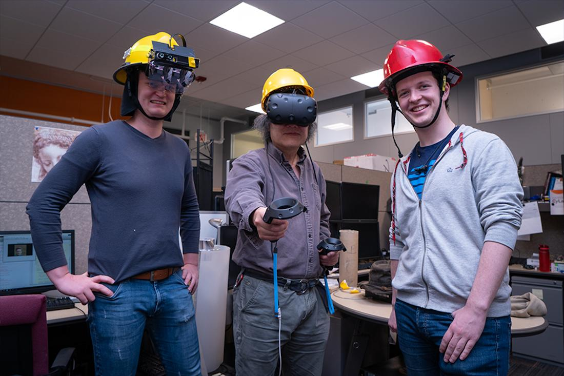 Researchers Florian Alber, Yang Cai, and Sean Hackett demonstrate Haptic Helmet prototypes
