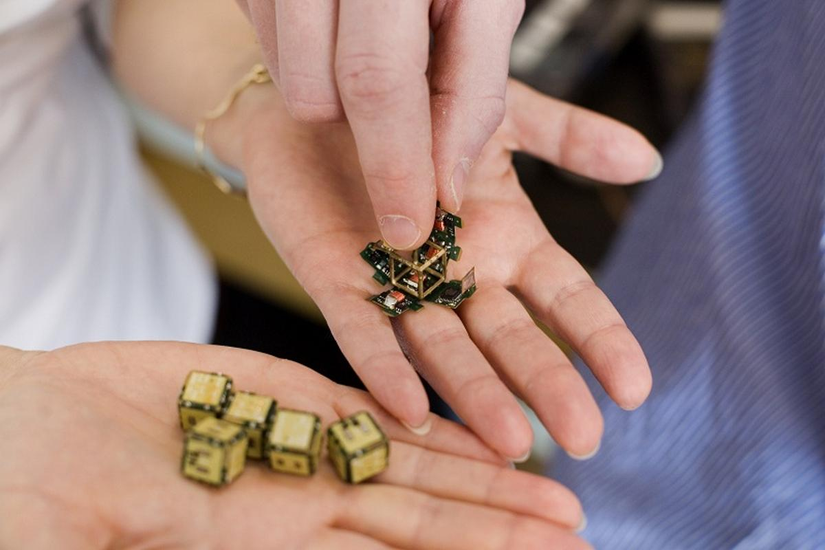 """Smart pebbles"" are cubes about 10 millimeters to an edge, with processors and magnets built in (Photo: M. Scott Brauer)"