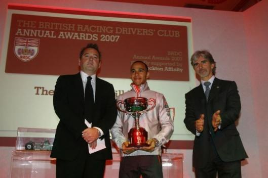Formula One driver Lewis Hamilton receives the Graham Hill Trophy