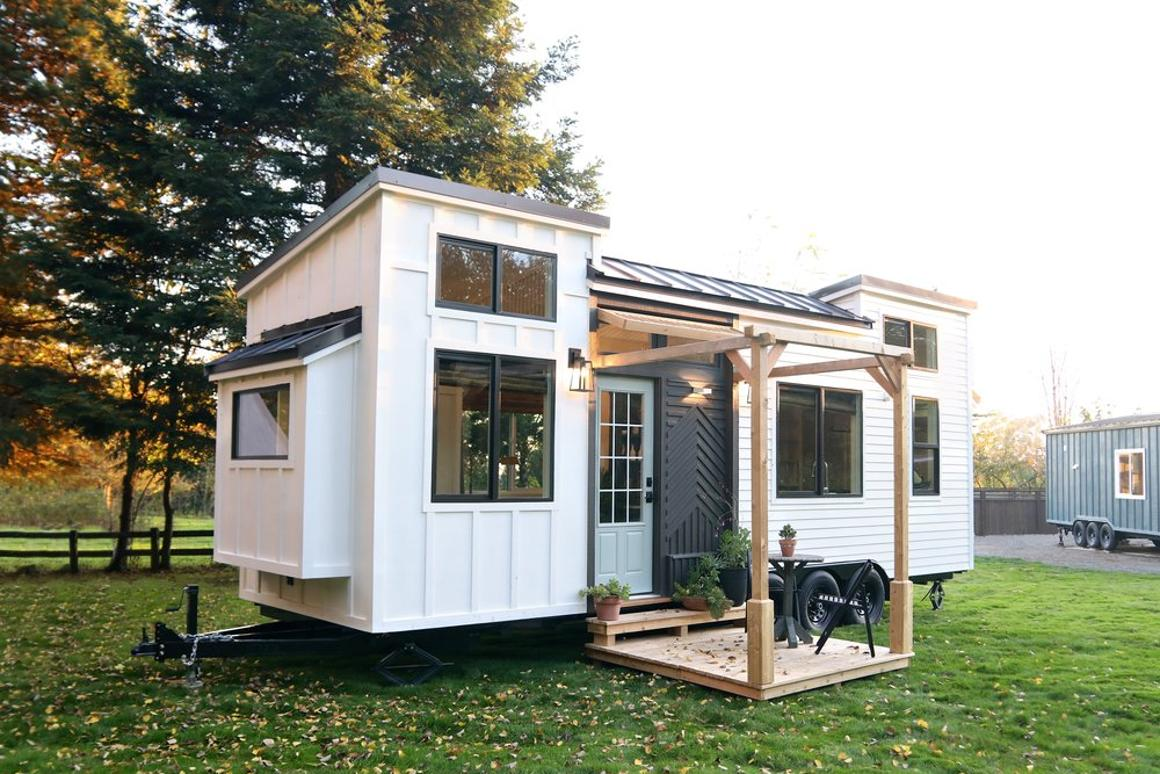 Access to thePacific Harmonyis over a small porch area and through a door in the center of the tiny house