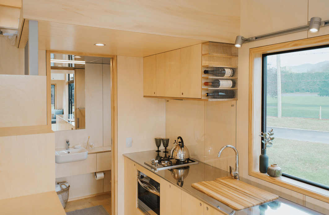 The First Light Tiny House's kitchen includes a large counter finished in stainlesssteel