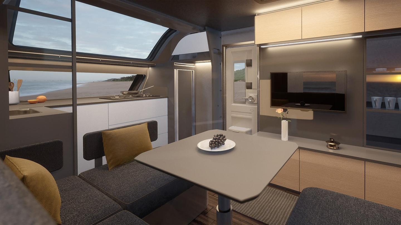 Setzen Sie sich an den Essbereich des Maxia und sehen Sie aus dem Panoramafenster und dem Fernseher