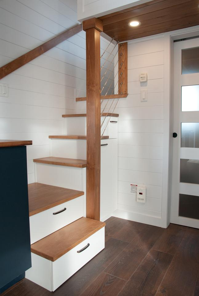 The Charme V2's main loft bedroom is reached by storage-integrated staircase