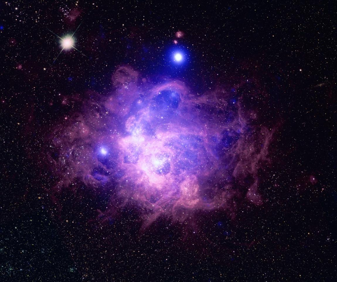 The massive star forming region NGC 604, located in the galaxy Messier 33 –Chandra data can be seen in blue while Hubble optical data is shown in purple