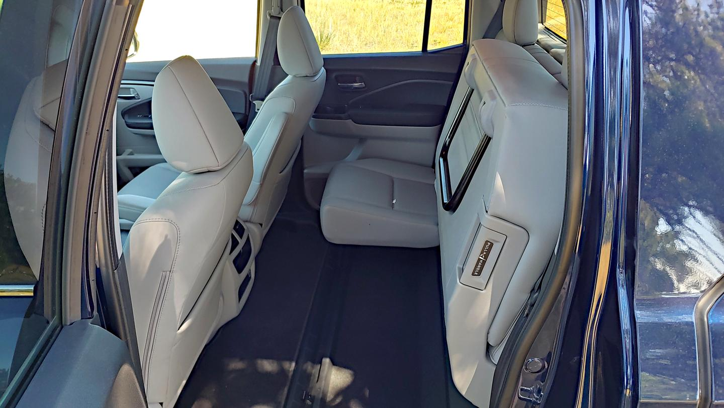 The rear seats in the 2020 Honda Ridgeline fold up to create a large load floor for added utility