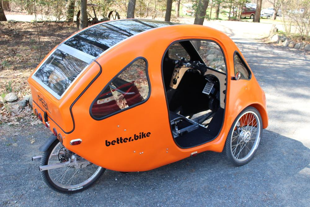 The PEBLfeatures some automobile-like amenities, while still being legally classified as an electric bicycle