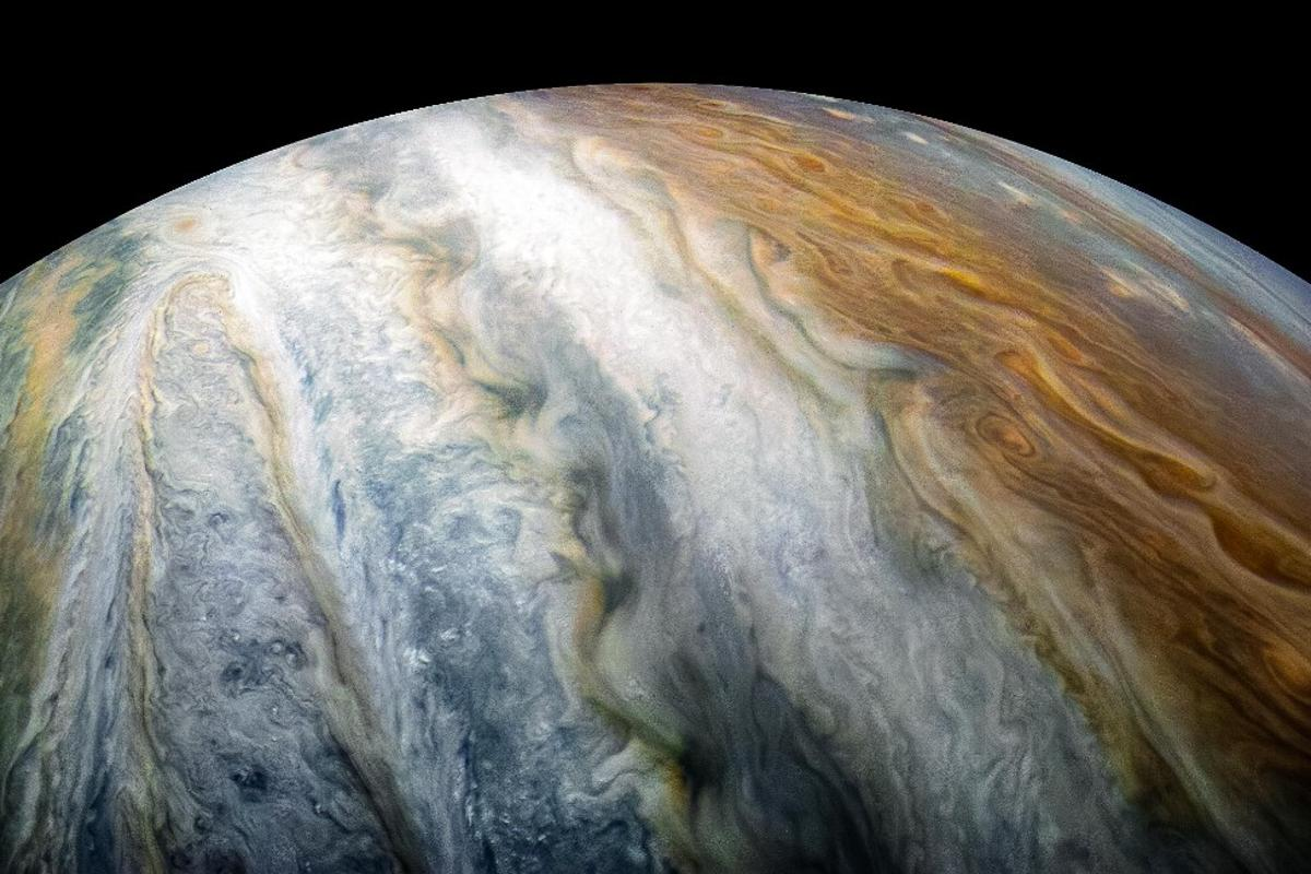 The gas giant Jupiter, as seen here in a color-enhanced Juno image, is one of the worlds included in the new reference catalog