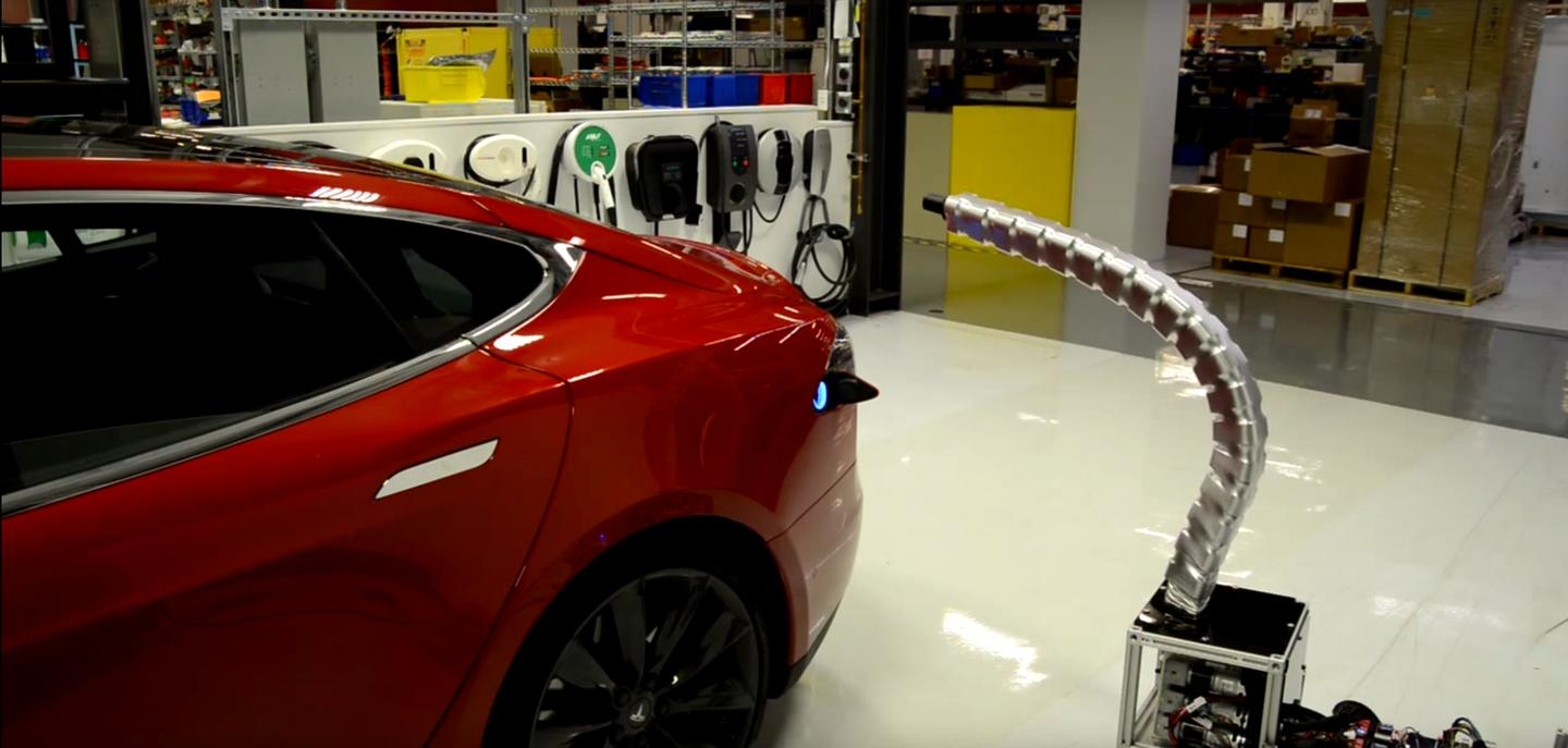 Tesla's prototype robotic charger snaking its way into a Model S