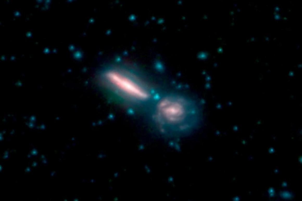 Two merging galaxies known as Arp 302, also called VV 340