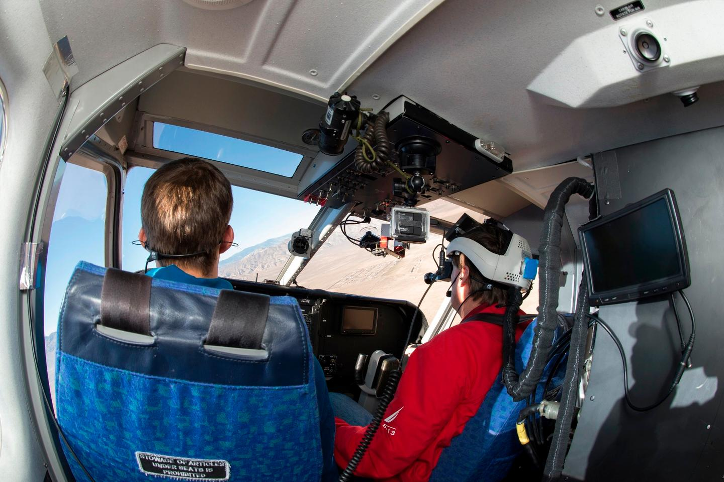 Dave Fedors wears the Fused Reality helmet while flying the Gippsland GA-8 Airvan