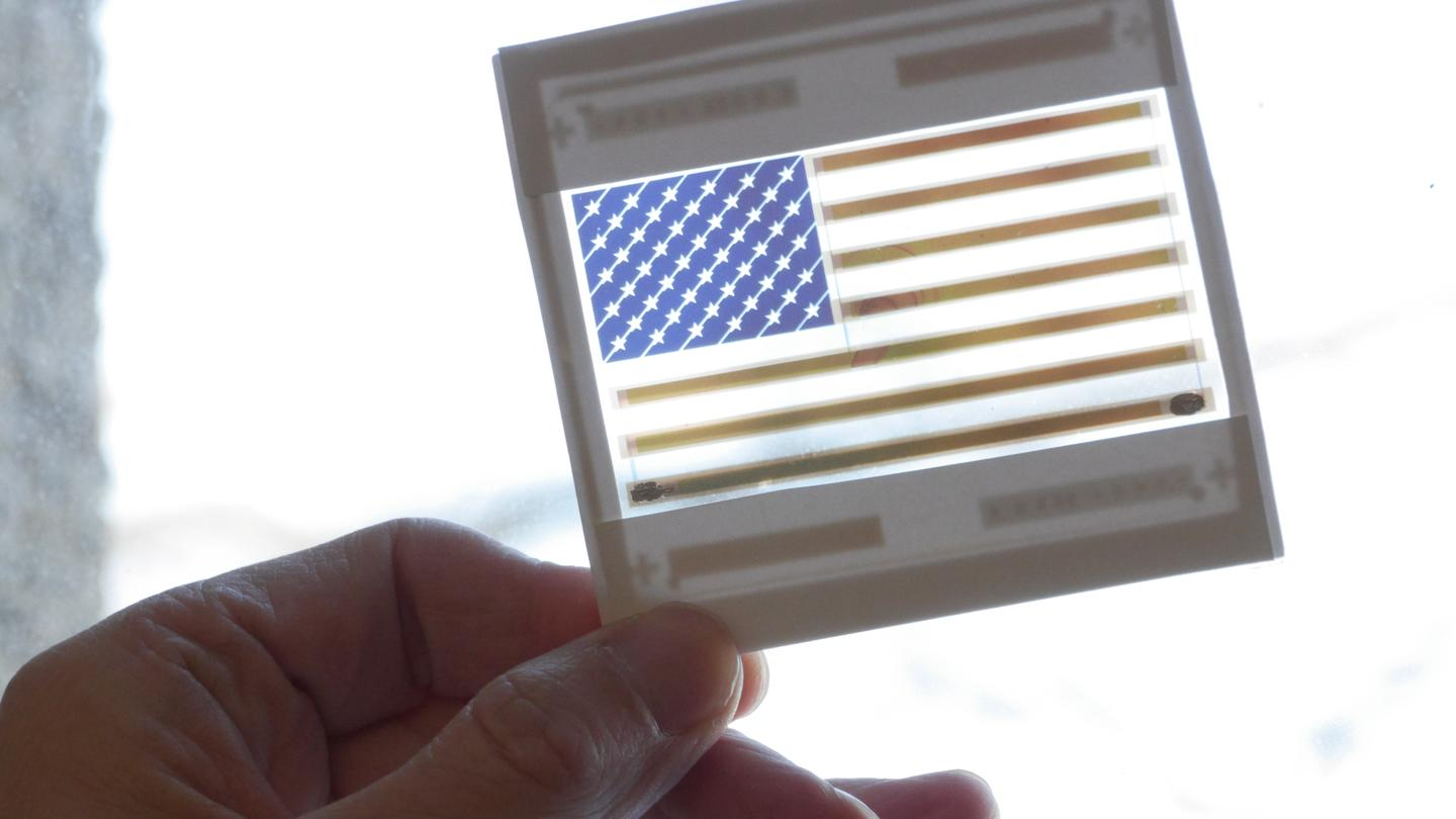 This colorful American flag is in reality a functional and transparent solar cell (Photo: Joseph Xu, Michigan Engineering Communications & Marketing)