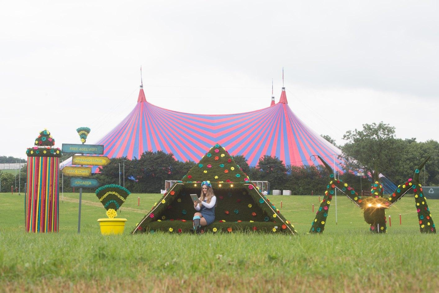 The structures take the form of mini versions of some of Glastonbury's most famous landmarks, like the Pyramid Stage, the Arcadia spider and the Park Tower