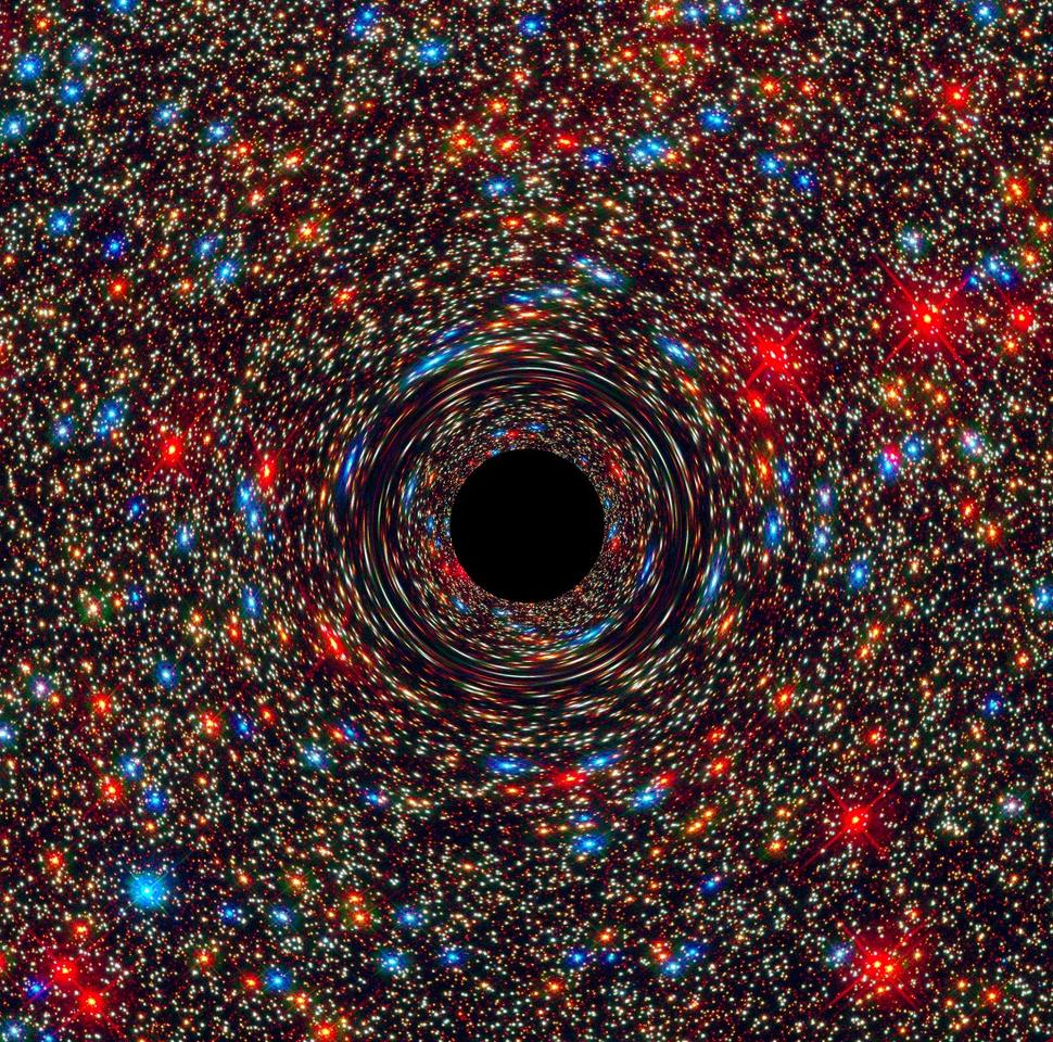 "A computer-simulated image of a black hole showing how the its monster gravity distorts the space around it ""like a funhouse mirror,"" according to NASA"
